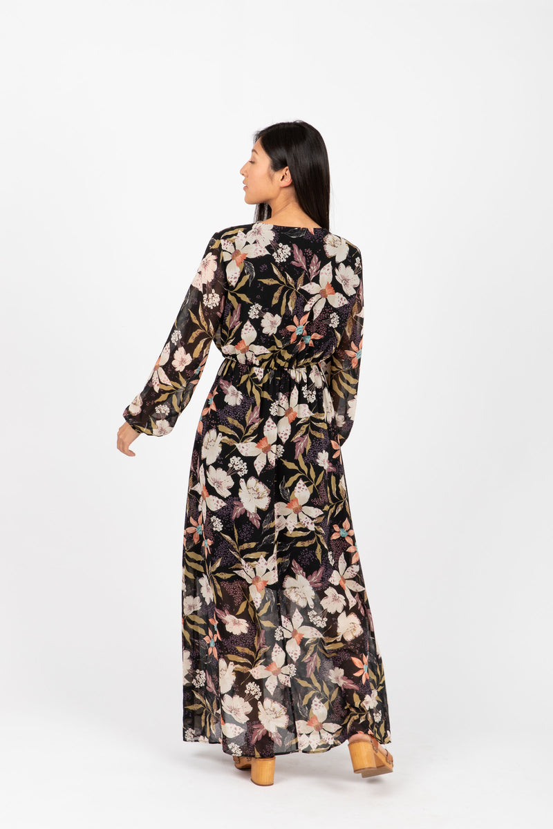 The Major Floral Wrap Maxi Dress in Black, studio shoot; back view