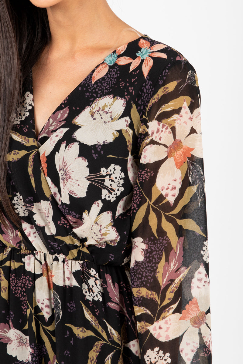 The Major Floral Wrap Maxi Dress in Black, studio shoot; closer up front view