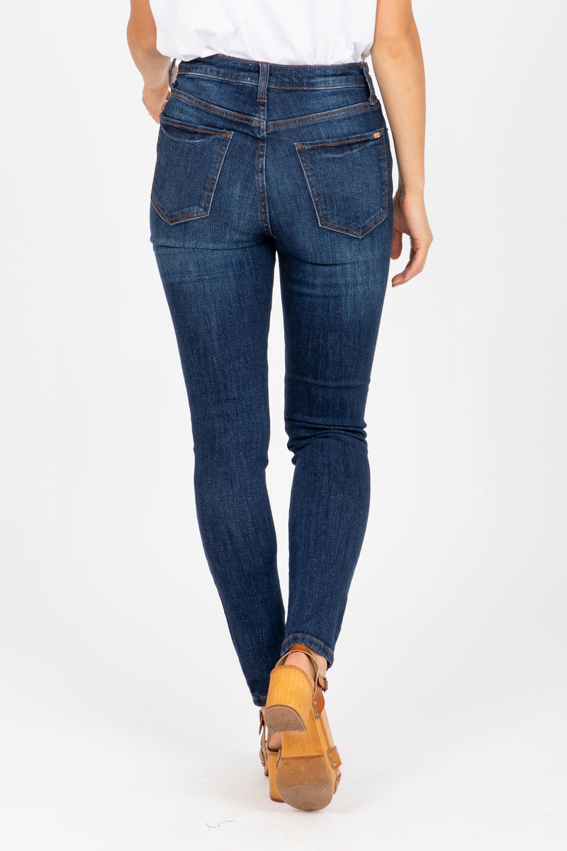 The New Denim High Rise Exposed Button Skinny in Medium Dark