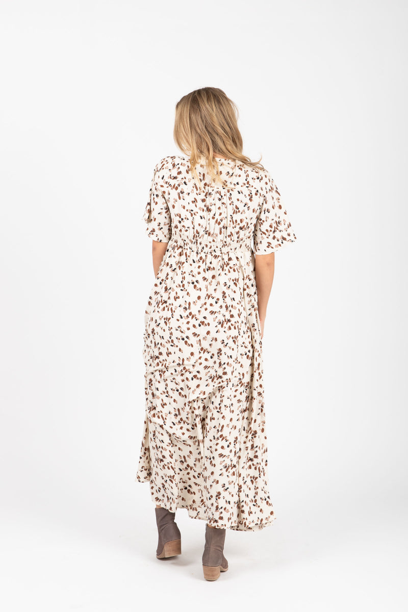 The Mighty Leopard Maxi Dress in Ivory, studio shoot; back view