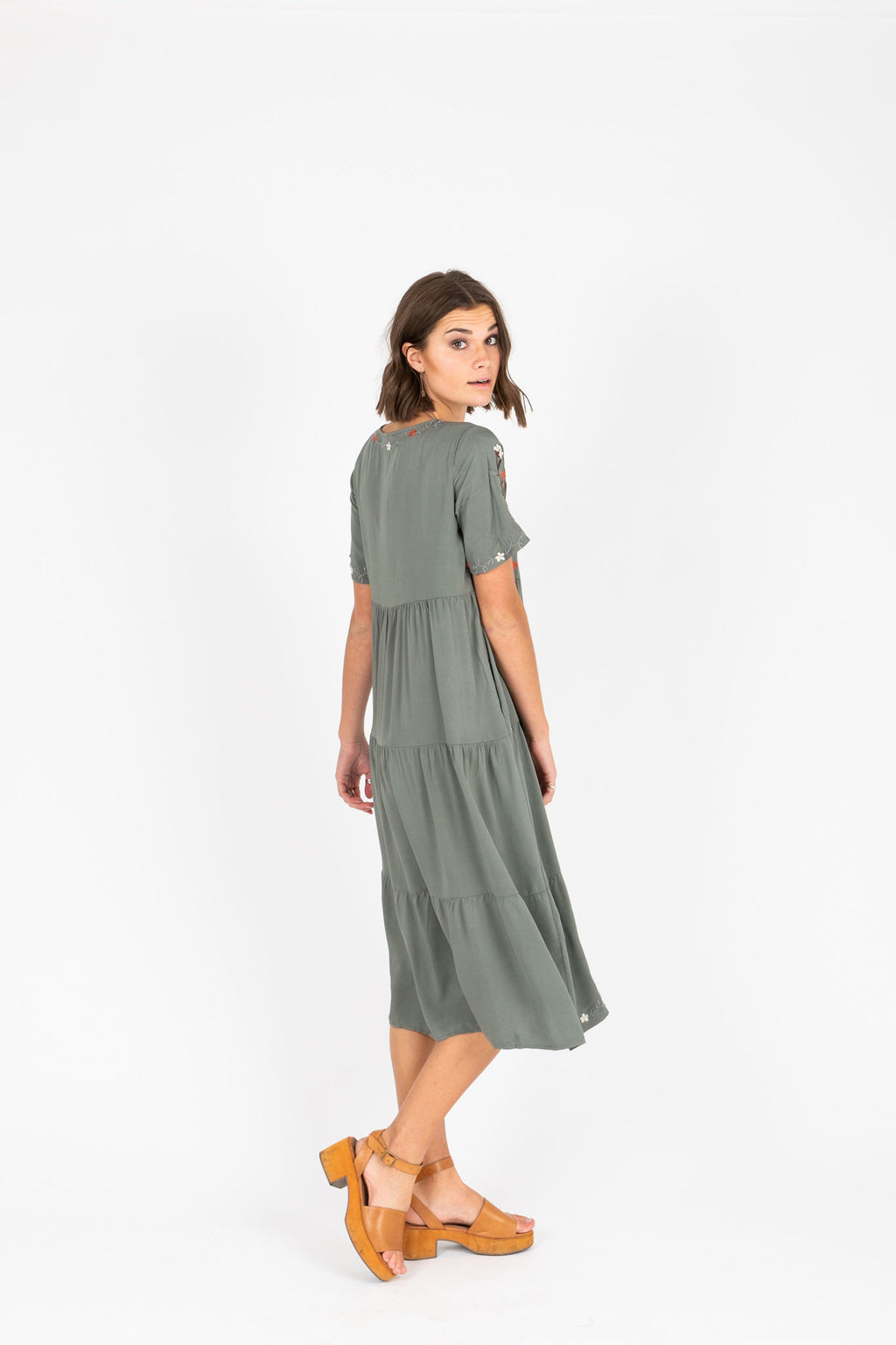 The Sonita Embroidered Tiered Dress in Olive, studio shoot; side view