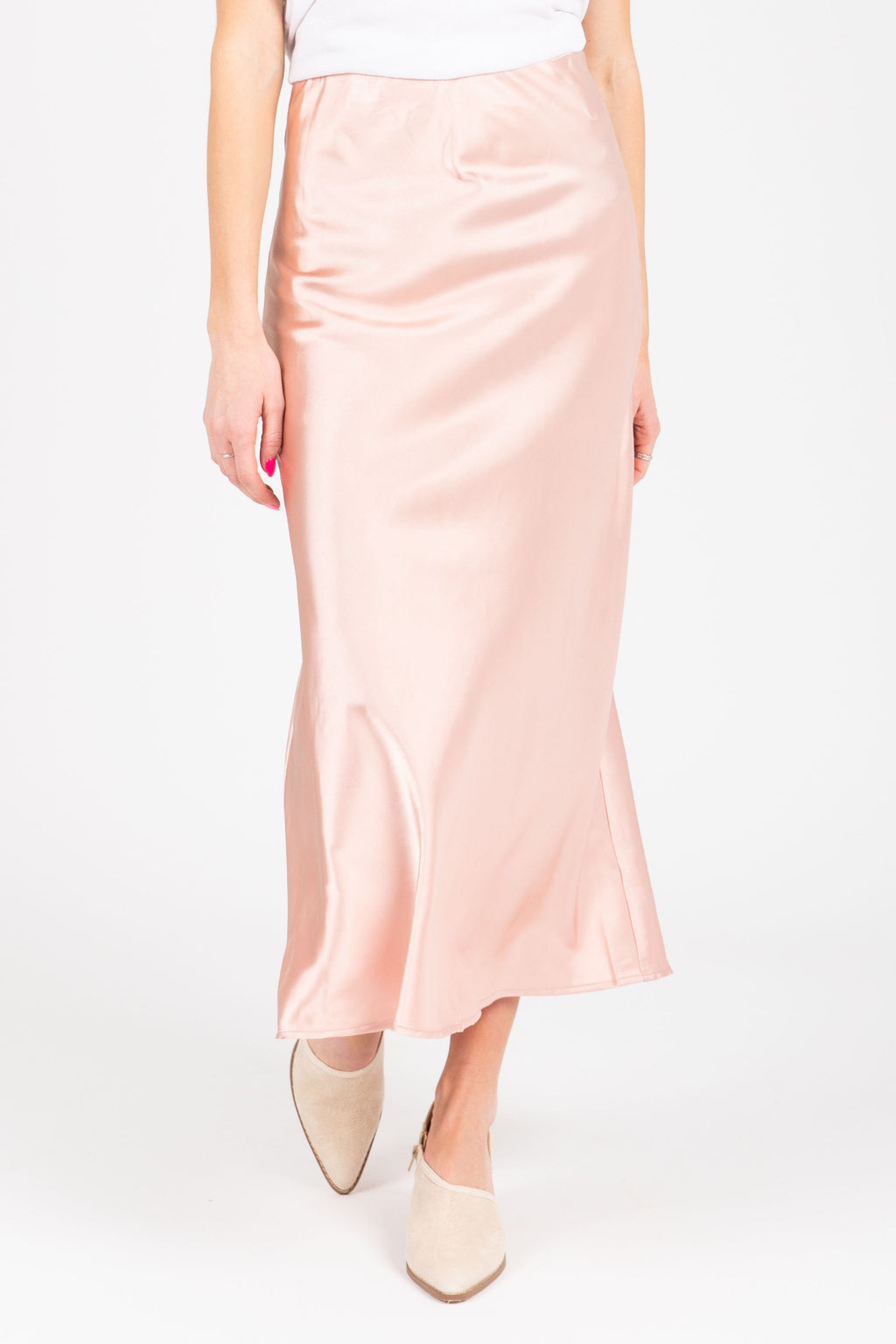 The Lilyan Satin Midi Skirt in Blush, studio shoot; front view