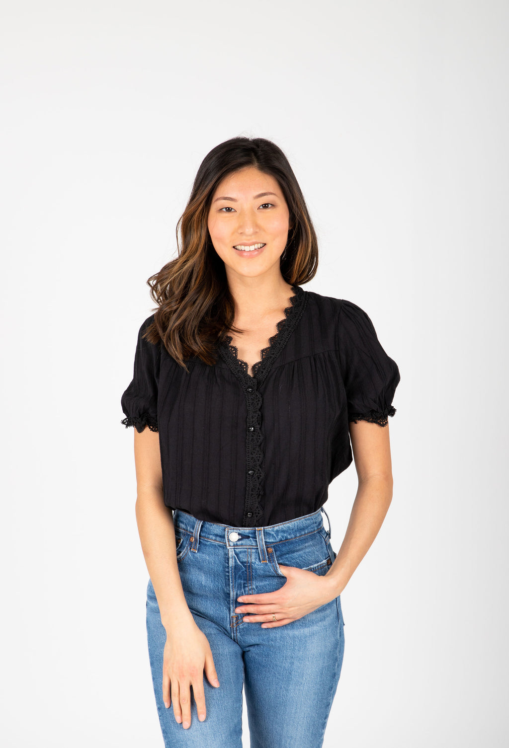 The Myla Detail Button Blouse in Black, studio shoot; front view