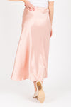 The Lilyan Satin Midi Skirt in Blush, studio shoot; back view