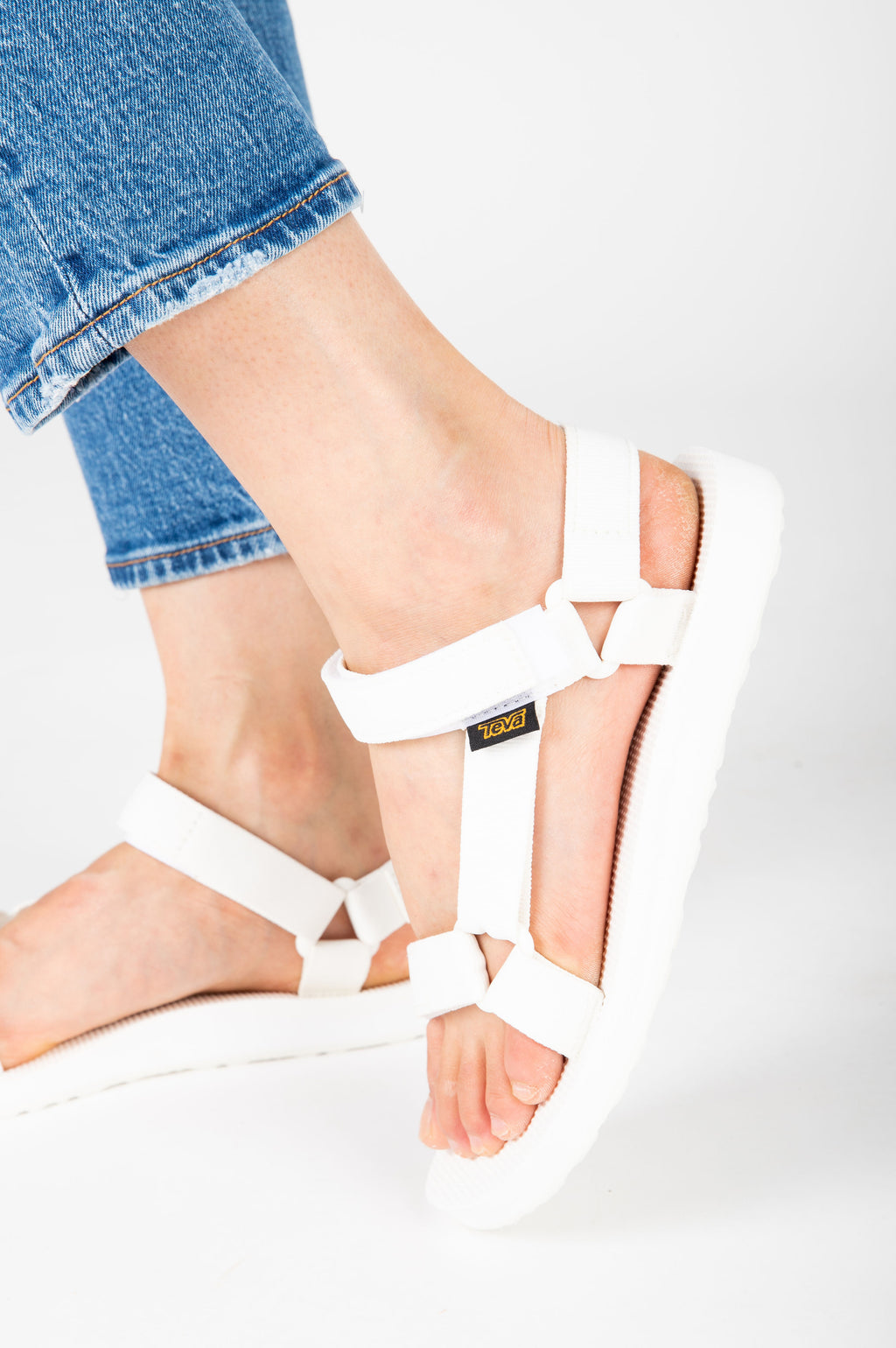 , Teva: Original Universal in Bright White, studio shoot; side view