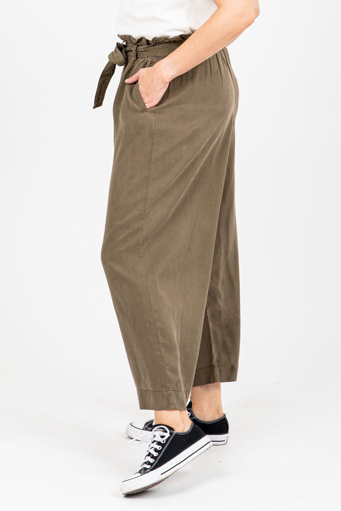 The Gleeson Belted Casual Trouser in Olive, studio shoot; side view