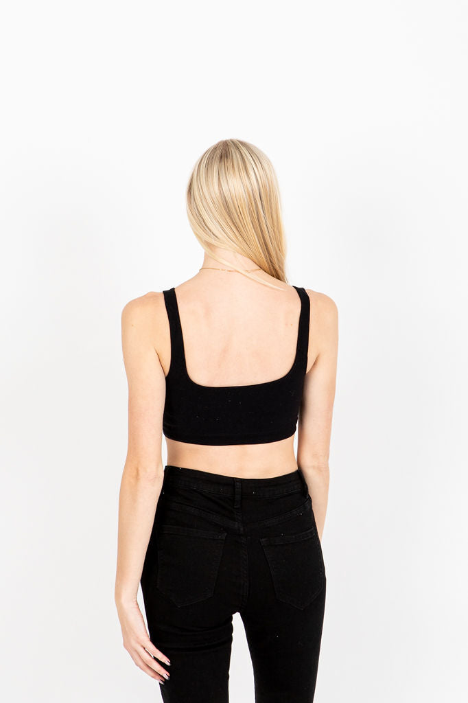 The Moody Ribbed Crop Tank in Black, studio shoot; back view