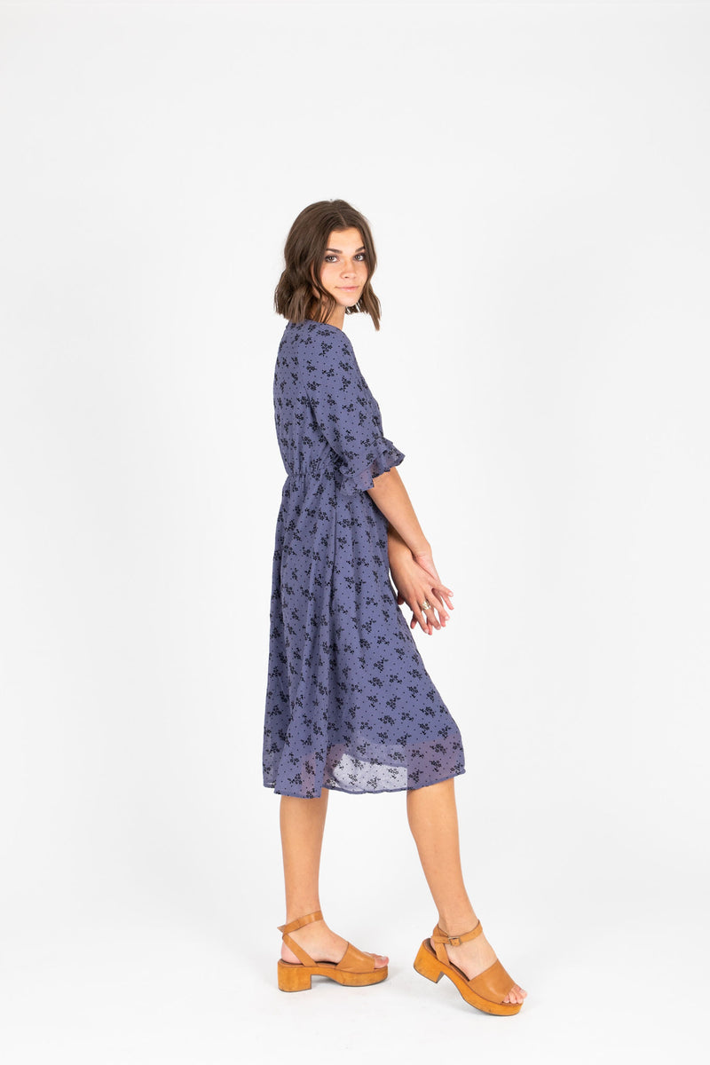 The Gabby Floral Detail Dress in Dusty Blue, studio shoot; side view