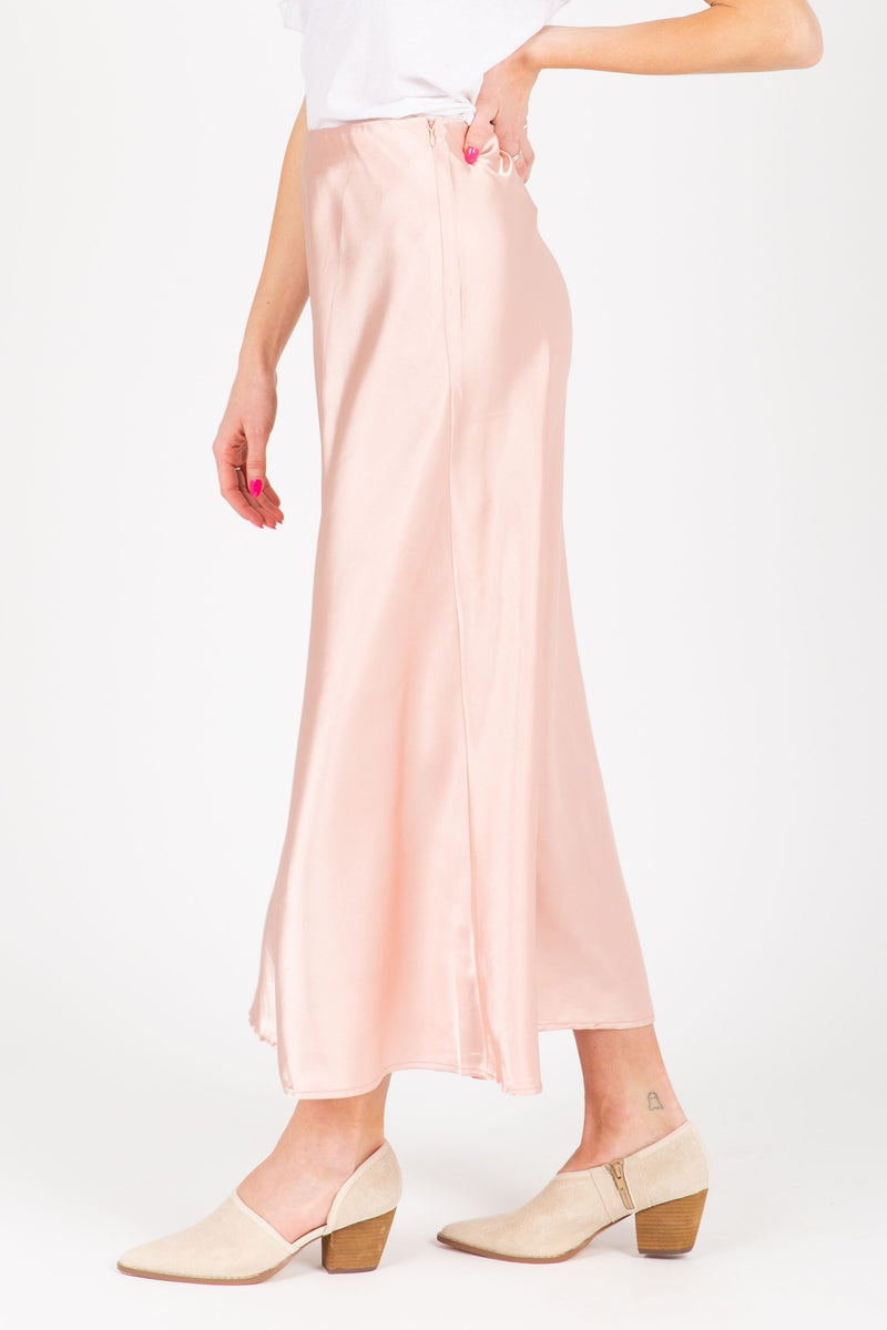 The Lilyan Satin Midi Skirt in Blush, studio shoot; side view