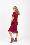 The Simon Lace Midi Dress in Plum, studio shoot; side view