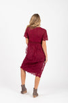 The Simon Lace Midi Dress in Plum, studio shoot; back view