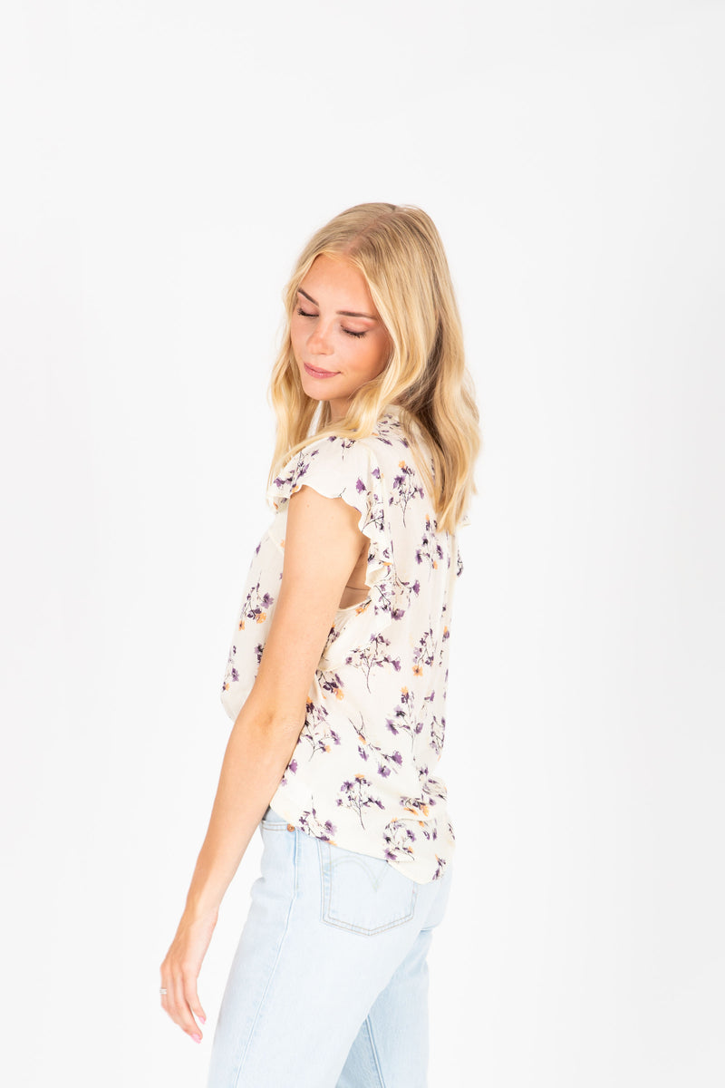 The Dante Delicate Floral Blouse in Ivory, studio shoot; side view