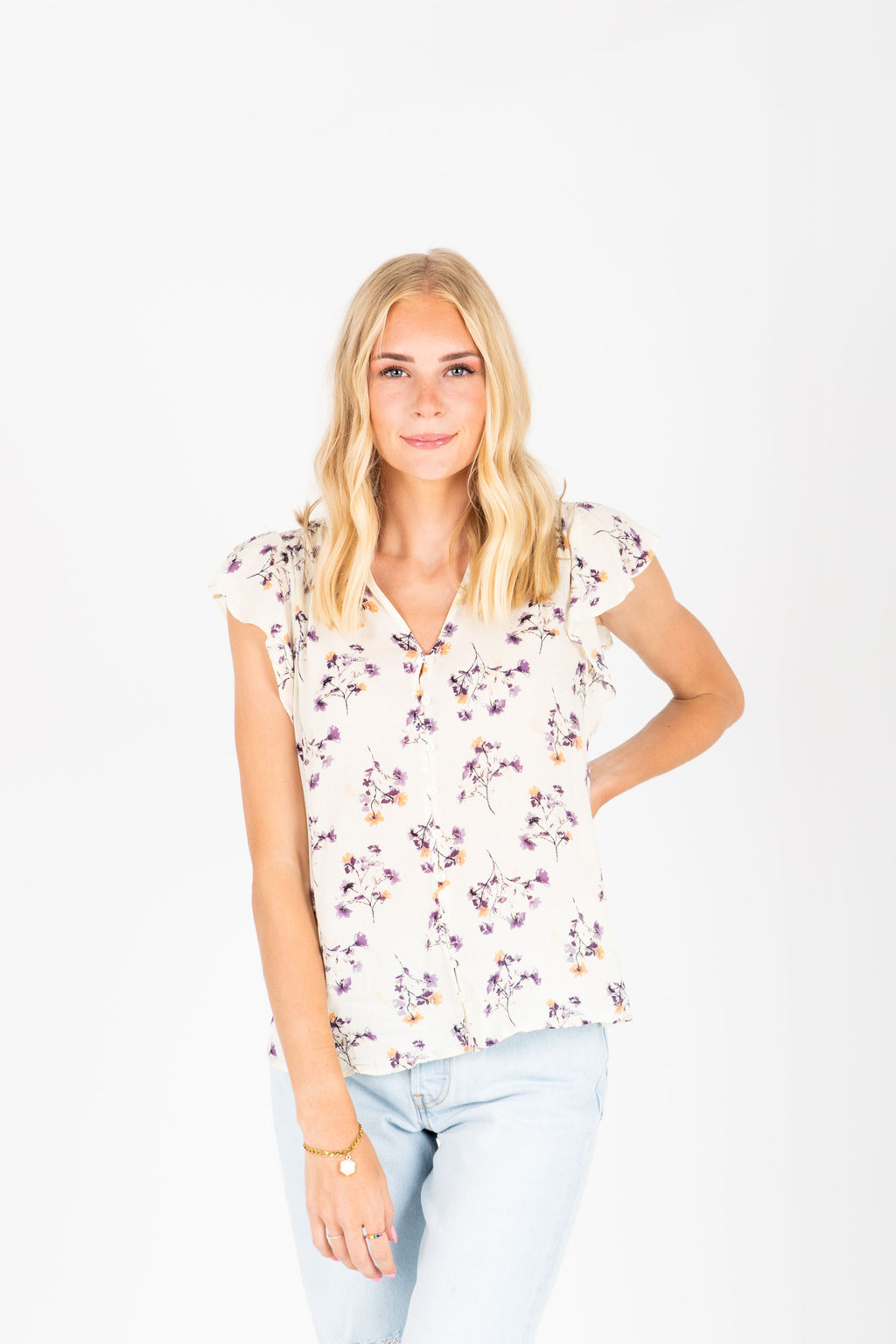 The Dante Delicate Floral Blouse in Ivory, studio shoot; front view