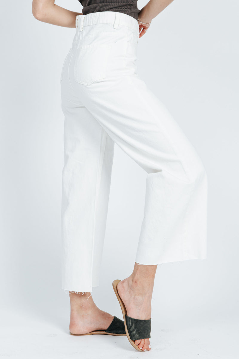 The Colten Wide Leg Denim Pant in White, studio shoot; side view