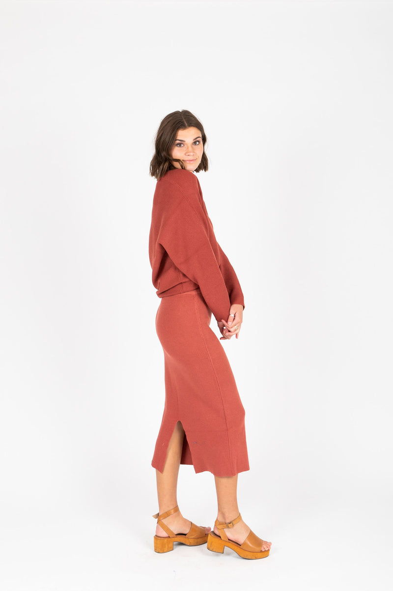 The Tamara Knit Skirt in Brick, studio shoot; side view