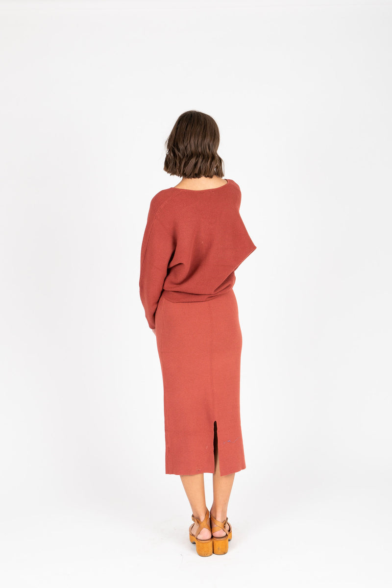 The Tamara Knit Skirt in Brick, studio shoot; back view