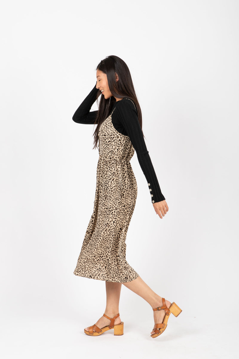 The Unreal Leopard Tank Dress in Coco, studio shoot; side view