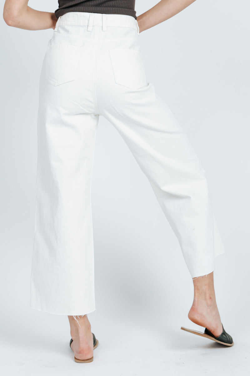 The Colten Wide Leg Denim Pant in White, studio shoot; back view