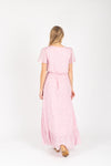 The Soar Floral Ruffle Maxi Dress in Mauve, studio shoot; back view