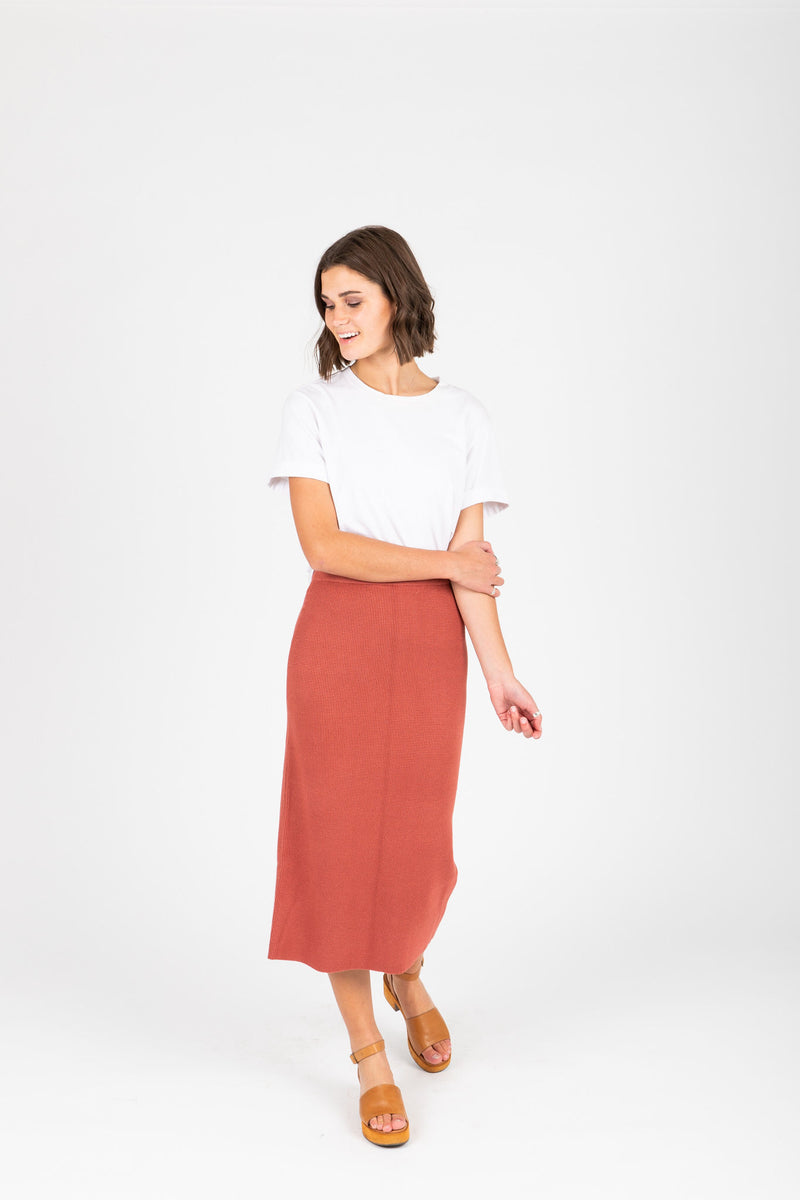 The Tamara Knit Skirt in Brick, studio shoot; front view
