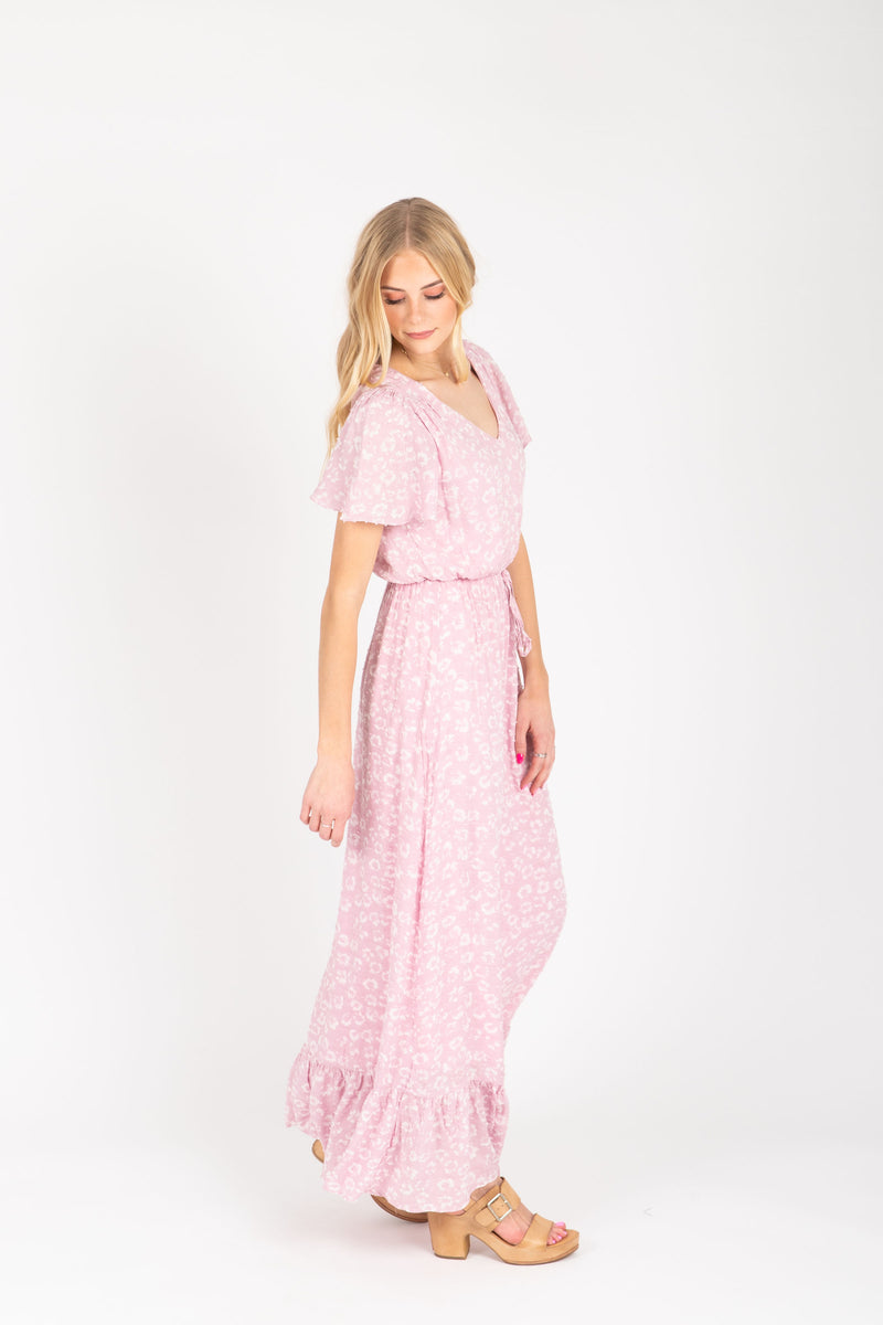 The Soar Floral Ruffle Maxi Dress in Mauve, studio shoot; side view