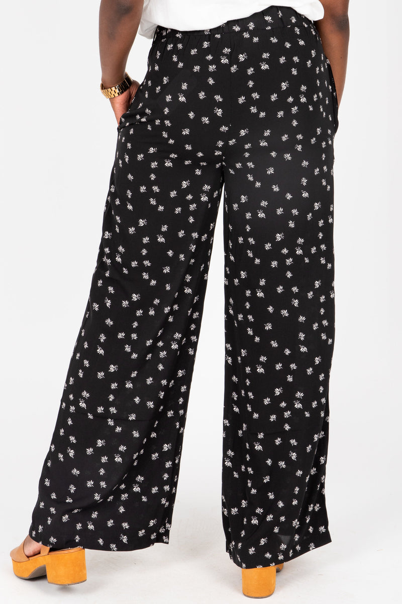 The Corbin Printed Wide Leg Trouser in Black, studio shoot; back view
