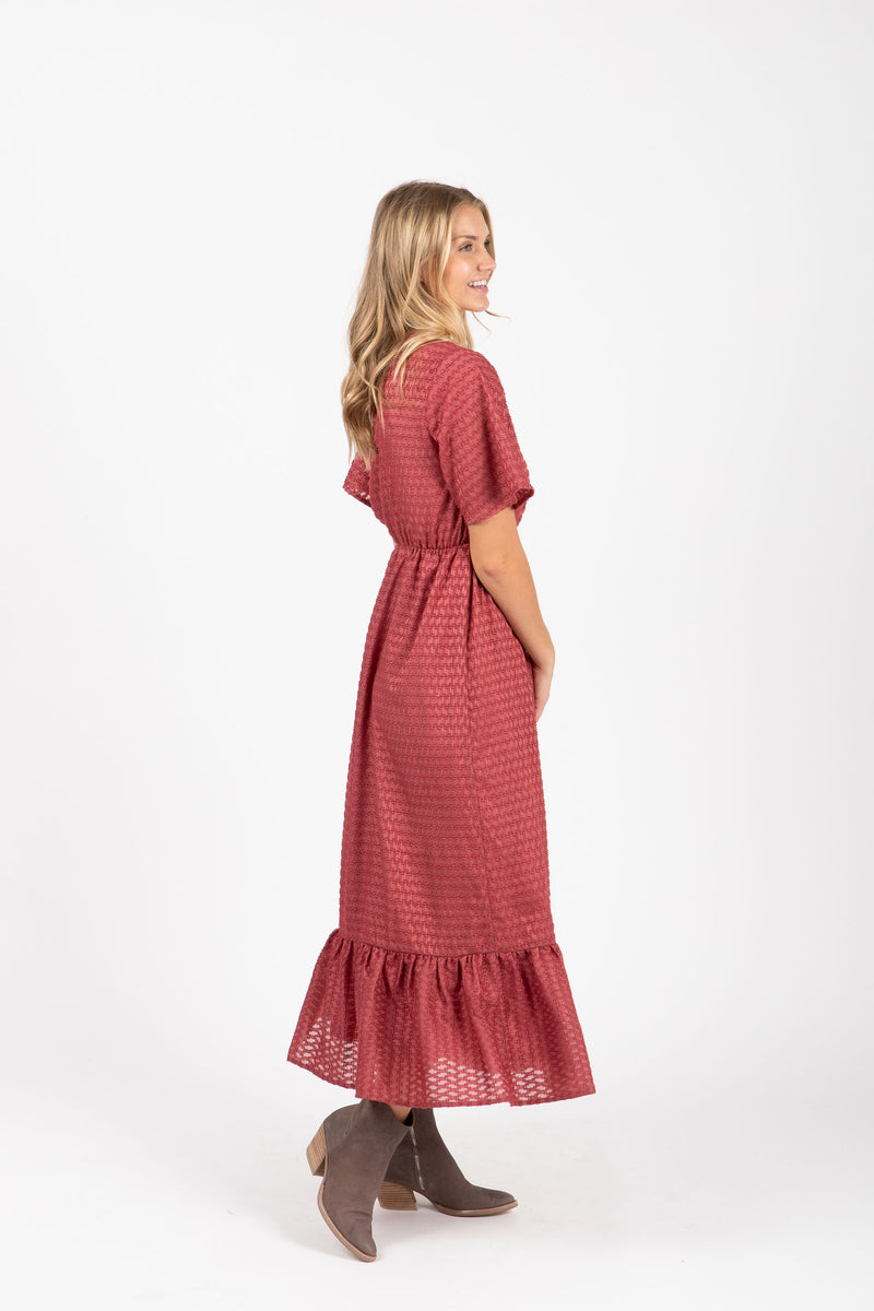The Romy Patterned Ruffle Dress in Burgundy, studio shoot; side view