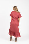 The Romy Patterned Ruffle Dress in Burgundy, studio shoot; back view
