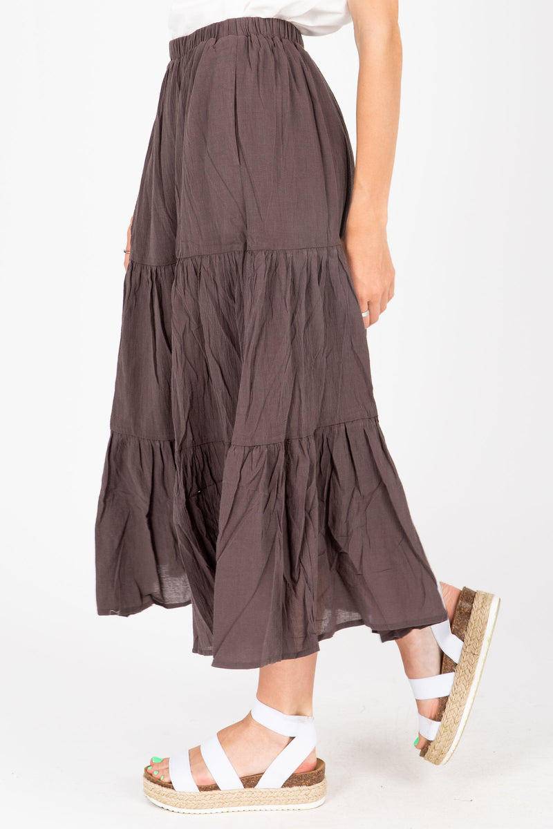 The Ali Tiered Skirt in Charcoal, studio shoot; side view