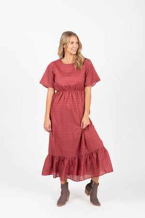 The Romy Patterned Ruffle Dress in Burgundy, studio shoot; front view