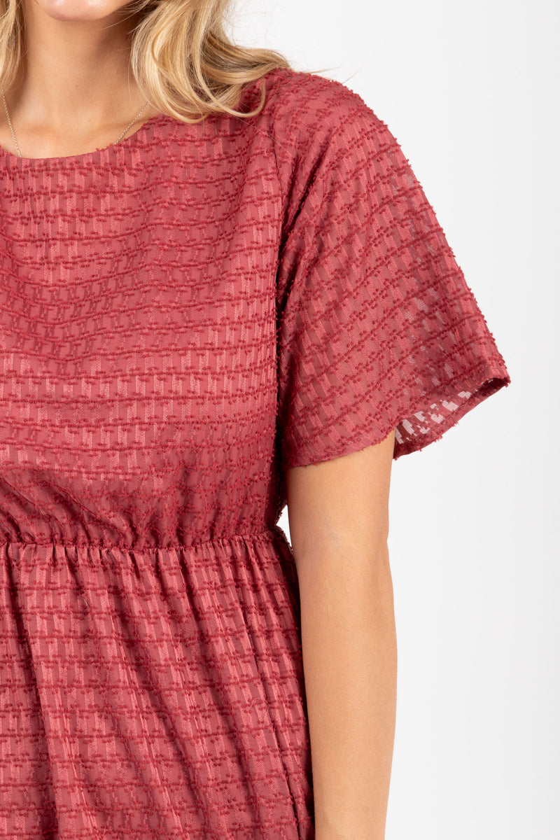 The Romy Patterned Ruffle Dress in Burgundy, studio shoot; closer up front view