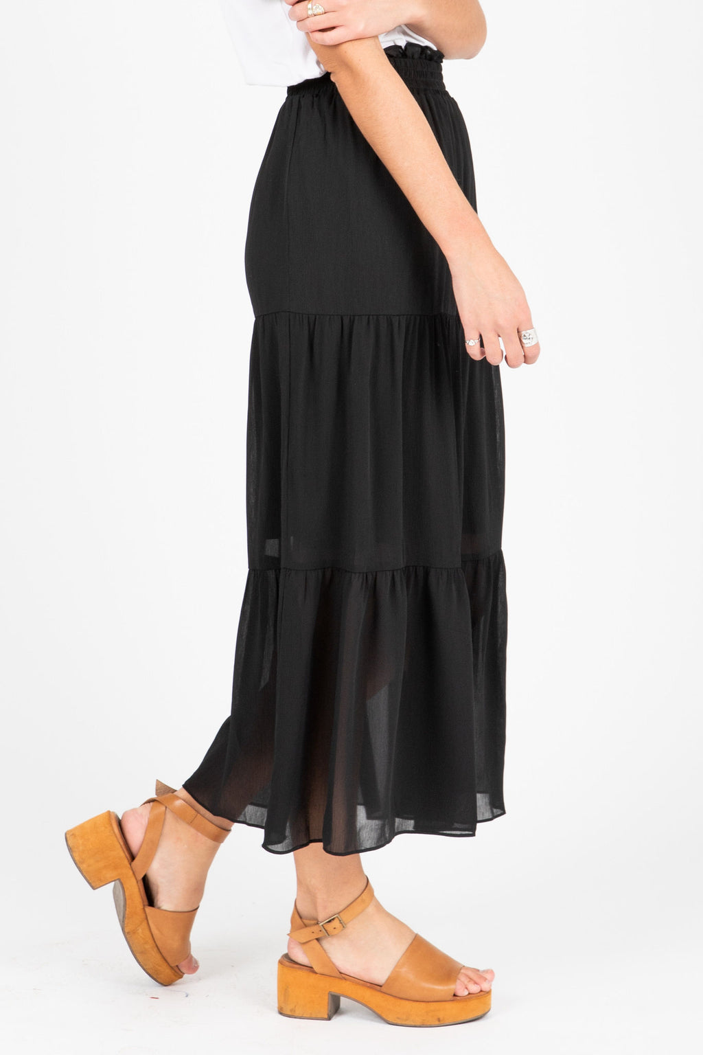 The Jason Tiered Skirt in Black, studio shoot; side view