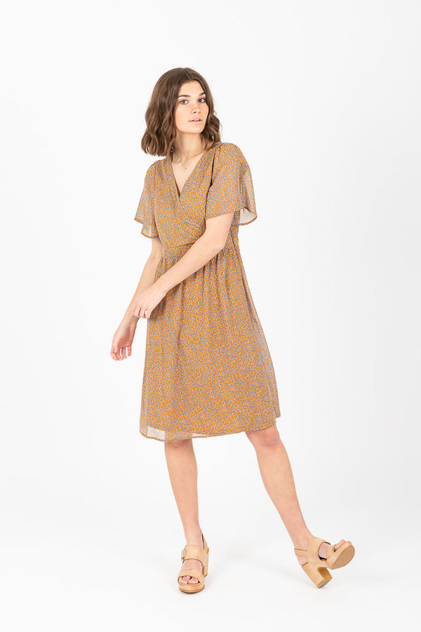 5a836b3efe6b Piper   Scoot  The Peyton Wrap Flutter Sleeve Dress in Mustard