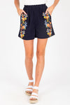 The Rem Embroidered Shorts in Navy, studio shoot; front view