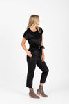 Piper & Scoot: The Bianca Cinch Velvet Jumpsuit in Black, studio shoot; side view