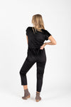 Piper & Scoot: The Bianca Cinch Velvet Jumpsuit in Black, studio shoot; back view