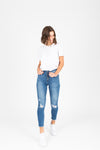 The Liz High Rise Button Skinny Jeans, studio shoot; front view