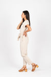 Piper & Scoot: The Bianca Cinch Velvet Jumpsuit in Beige, studio shoot; side view
