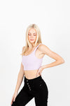 The Moody Ribbed Crop Tank in Lavender, studio shoot; side view