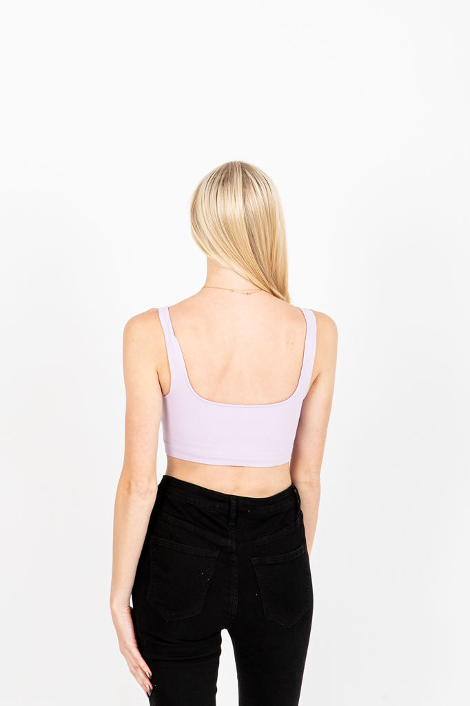 The Moody Ribbed Crop Tank in Lavender, studio shoot; back view