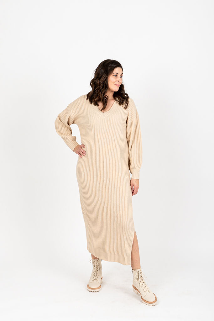 The Vernon Ribbed V-Neck Sweater Dress in Oatmeal, studio shoot; front view