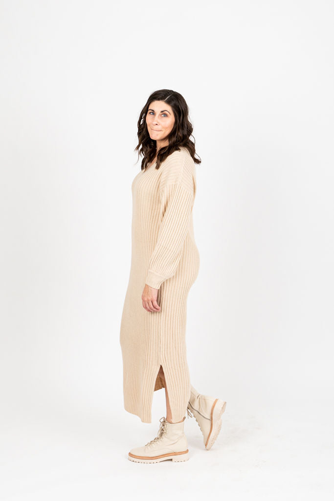 The Vernon Ribbed V-Neck Sweater Dress in Oatmeal, studio shoot; side view