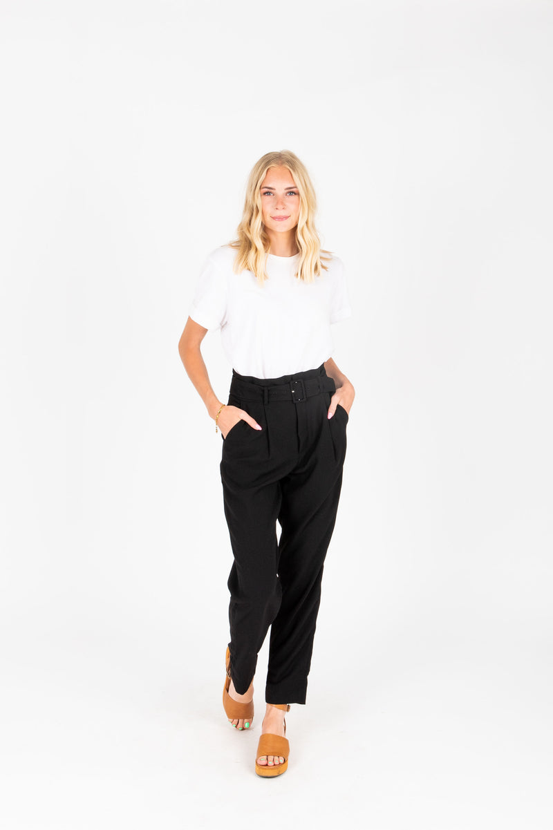 The Dallas Belted Trouser in Black, lifestyle shoot; front view