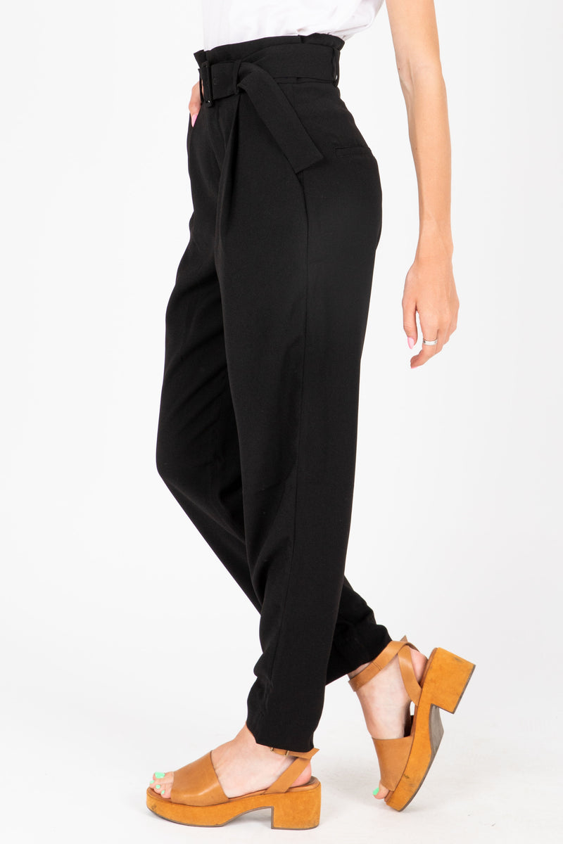 The Dallas Belted Trouser in Black, studio shoot; side view