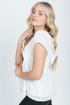 The Christie Smocked Ruffle Blouse in White, studio shoot; side view