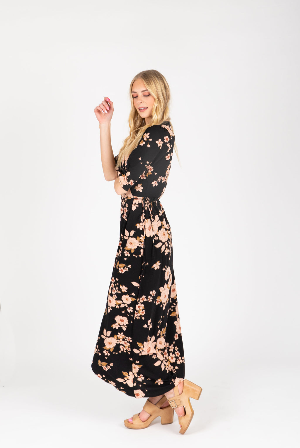 The Mattie Floral Wrap Dress in Black, studio shoot; side view