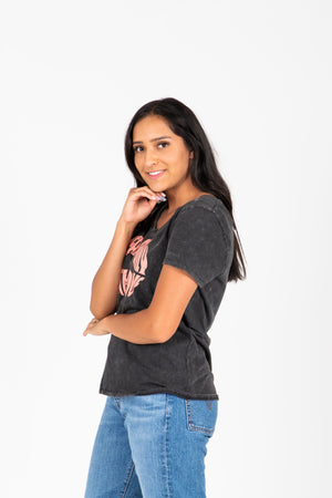 The Speak With Love Tee in Charcoal, studio shoot; side view