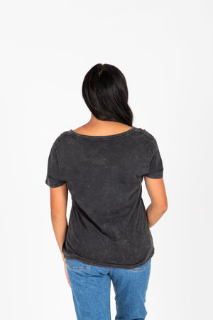 The Speak With Love Tee in Charcoal, studio shoot; back view