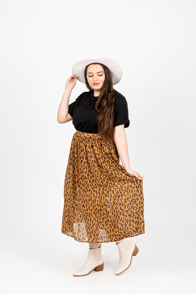 The Otho Leopard Midi Skirt in Camel, studio shoot; front view
