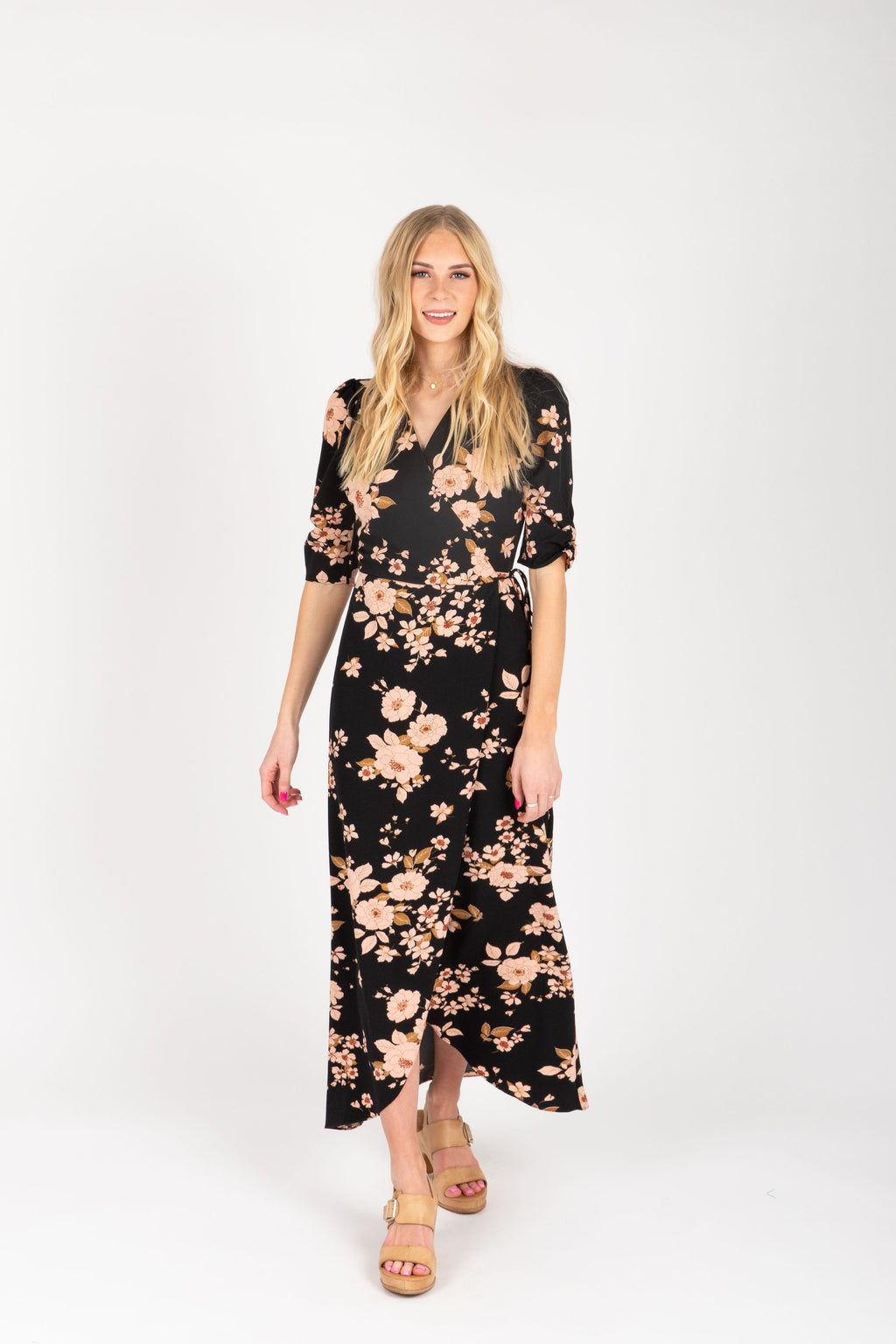 The Mattie Floral Wrap Dress in Black, studio shoot; front view